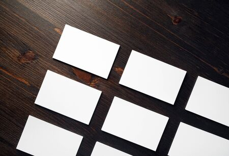 Photo of blank white business cards mock-up on wooden background. Branding mock up. Flat lay. Foto de archivo - 135498909