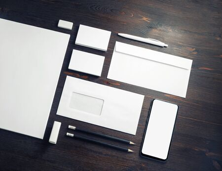 Photo of blank corporate stationery set on wooden background. Corporate ID template. Responsive design mockup. Foto de archivo - 135498910