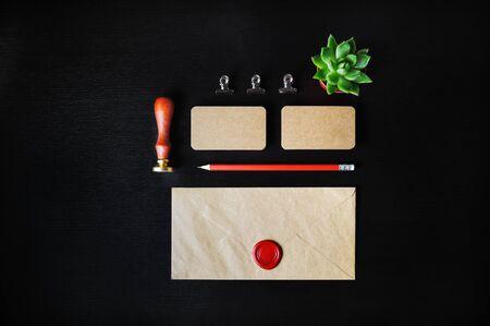 Vintage stationery mock up. Blank corporate identity template on black wooden background. Responsive design mockup. Flat lay. Reklamní fotografie