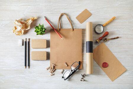 Blank kraft corporate stationery set on wooden background. Branding mock up. Flat lay. Reklamní fotografie