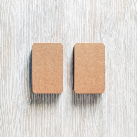 Photo of blank brown paper business cards. Template for branding identity. Flat lay.