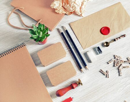 Blank vintage paperwork template for designers. Responsive design mockup on light wooden background 스톡 콘텐츠