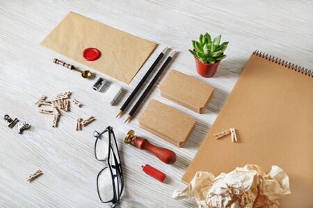 Blank vintage stationery and corporate identity template on light wooden background. For design presentations and portfolios. Stok Fotoğraf