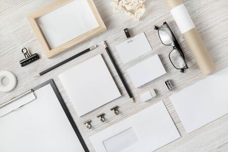 Photo of blank stationery set on light wooden background. Corporate identity template. Responsive design mockup.
