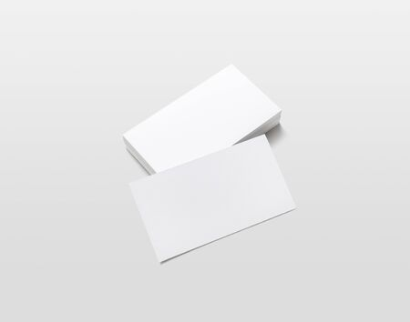 Photo of blank business cards with soft shadows on light gray background. For design presentations and portfolios. Isolated with clipping path. 스톡 콘텐츠