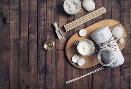 Beauty treatment products on vintage wooden background. Spa cosmetic background. Flat lay.