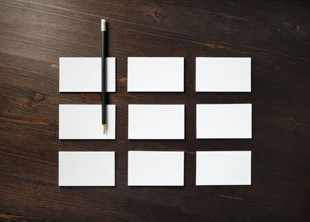 Blank business cards and pencil on wooden background. Mockup for branding identity for designers. Flat lay. 스톡 콘텐츠