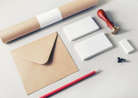 Photo of blank stationery set on paper background. Corporate identity template. Responsive design mockup.
