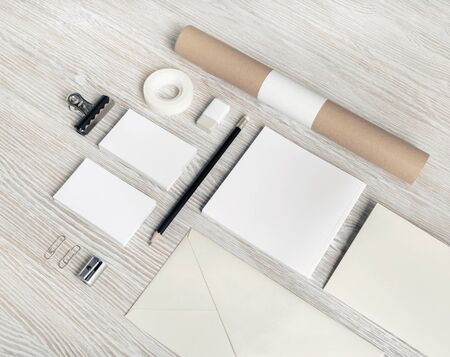 Blank stationery set on light wooden background. ID template. Mockup for branding identity for designers.