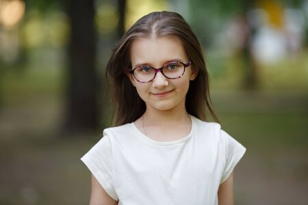 Portrait of child girl with glasses outdoors. Selective focus.