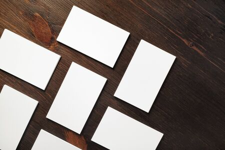 Photo of blank business cards on wooden background. Template for ID. Flat lay. 스톡 콘텐츠