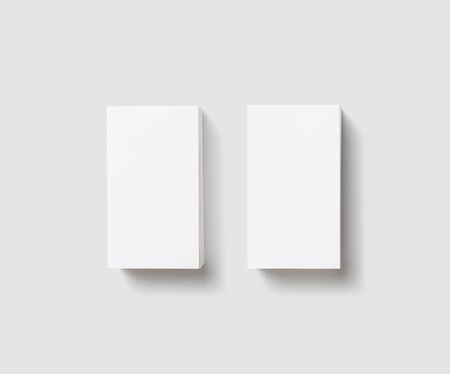 Blank white business cards on light gray background. Mockup for branding identity. Isolated with clipping path. Flat lay. 스톡 콘텐츠