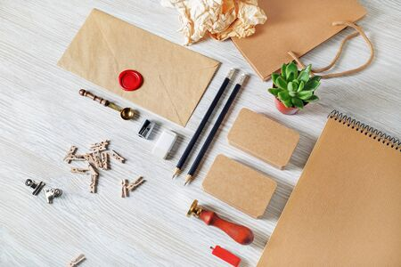 Photo of blank retro stationery set on light wooden background. Template for design presentations and portfolios. 스톡 콘텐츠