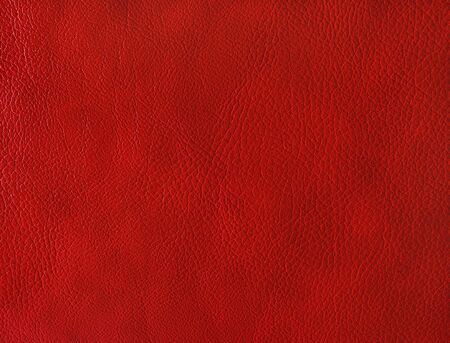 Red leather background. Photo of leather texture.