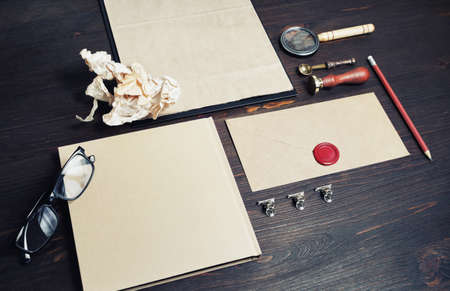 Photo of blank kraft stationery set on wooden background. Business brand template. Branding mock up.