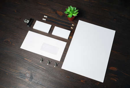 Blank corporate stationery set on wooden background. Branding mock up.