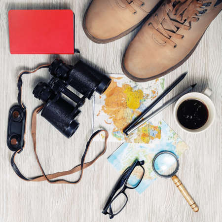 Preparation for travel. Tourist devices. Traveler's accessories on light wood table background. Planning vacation. Top view. Flat lay. Stock Photo
