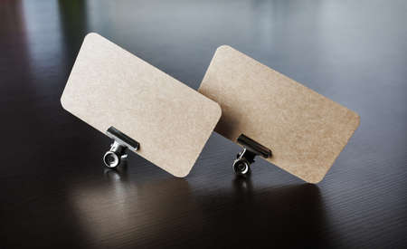 Photo of two blank kraft business cards. Branding ID template.