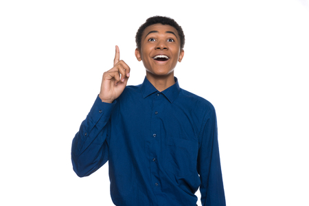 African American teenager has idea, raise index finger up. Isolated on white background. Studio portrait.