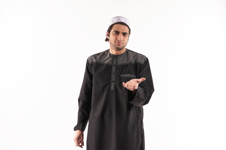 Arab adult man asks for favor. Isolated on pink background. Studio portrait.