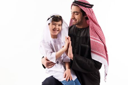 Arabian boy gives five fathers in keffiyeh. Parenthood concept. Isolated on white background.