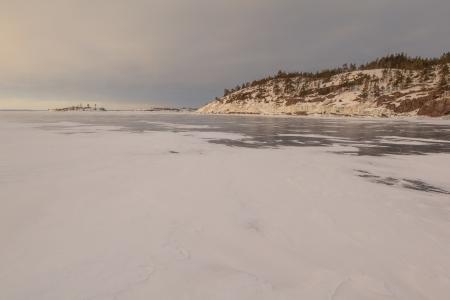 ladoga: Winter, stony coast of the frozen lake.  winter landscape Stock Photo