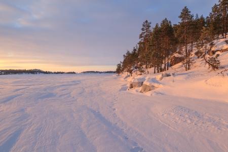 Winter, stony coast of morning Ladoga lake  A winter landscape photo
