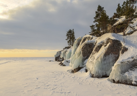 Winter, stony coast of the frozen lake.  winter landscape Stock Photo