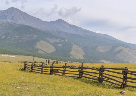Fence for cows and yaks in mountains. A landscape. photo