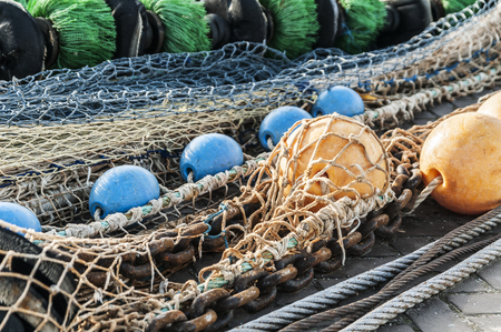 fishing nets spread out on the quay