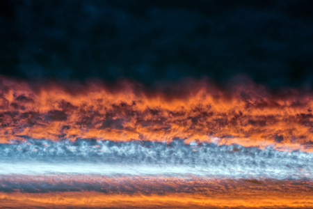 Orange clouds. Sinister sunset background texture nature