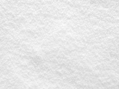Closeup fresh snow texture  Snow on the sun background  Stock Photo
