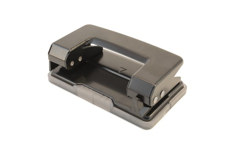 hole punch: Black office hole punch on a white background