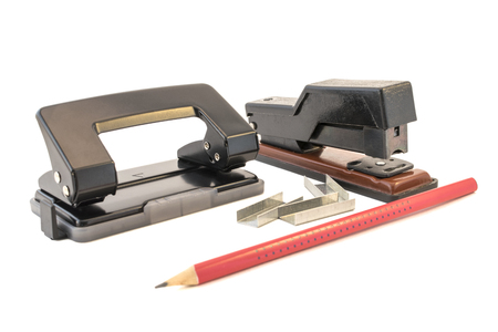 puncher: The stapler, puncher and pencil isolated on a white background