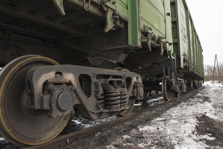 boxcar train: Railroad car undercarriage with wheels and springs.
