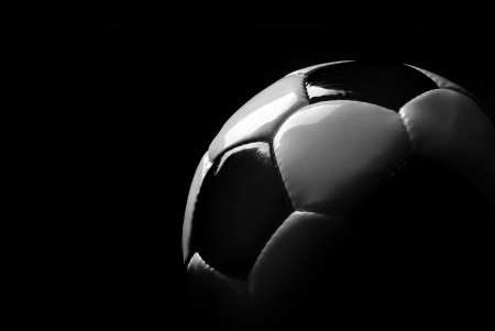 recreational sport: soccer ball detail on black background