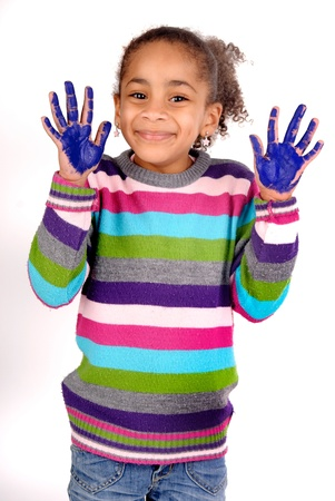 Five year old girl with hands painted Banco de Imagens