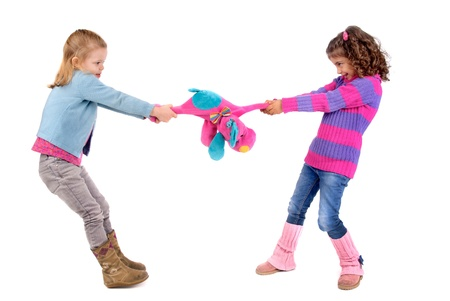two girls fighting over a toy