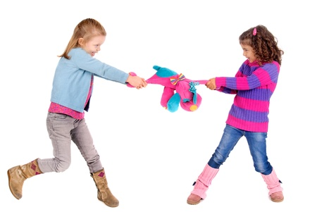 two girls fighting over a toy photo