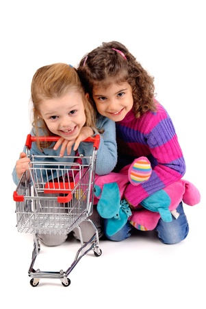 little girls with shopping cart photo