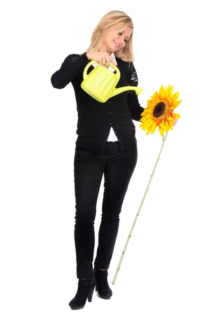 young woman watering flower photo