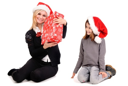 beautiful women holding christmas present Stock Photo - 17830205
