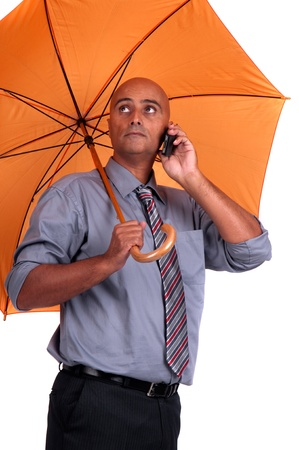 business man with umbrella photo