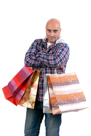 man isolated in white with shopping bags photo