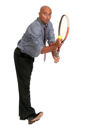 business man playing tennis Stock Photo
