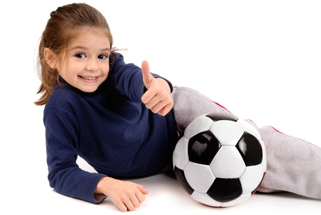 little girl with soccer ball