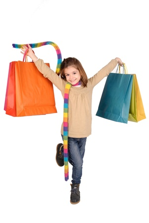 little girl with shopping bags