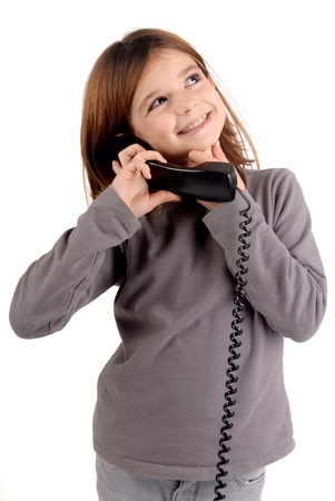little girl with telephone isolated in white photo