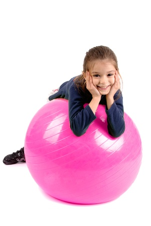little girl with pilates ball