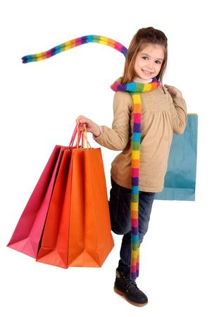 ni�os de compras: ni�a con bolsas de la compra Foto de archivo